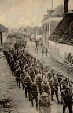 Marching Soldiers– A battalion of Newfoundland soldiers marching through a village in France during the First World War.