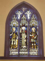 "Stained Glass Window– This memorial stained glass window ""Light of the World"" was erected in the Church, Parish of St Luke [Anglican, part of the Diocese of Rupert's Land] Address: 130 Nassau St North Winnipeg, MB. It was erected by the Parish of St Luke and unveiled in early 1920s. It was dedicated to Sub -Lieutenant John Elswood Chaffey Hough killed during the World War I.
