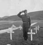Photo of Albert Gagnon– Albert Gagnon at the grave of his brother, Omer, killed in Korea at age 23, Pusan, Korea, 1952.