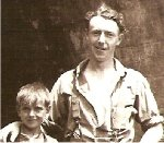 """Photo of Stanley Ward– Jesse R. MacKinnon (b. 1919) standing with Stanley Arthur """"Buddy"""" Ward (b: 7 July 1932 - d: 23 October 1952 - killed in action,  Korea).  Photo taken at the """"Deep Hole"""", a swimming hole under the Canadian National Railway line on the Frosty Hollow Brook, Sackville, New Brunswick; near Stanley's home."""