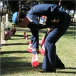 Captain Dan Zegarac planting the Canadian Flag