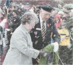 Photo of Ruth Decoste– Mrs. Ruth Decoste, the Memorial (Silver) Cross Mother, lays a wreath at the Remembrance Day ceremonies in Charlottetown, Prince Edward Island, on November 11, 2001.