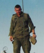 Photo of Scott Fraser Smith– Scott is standing on the armoured vehicle.