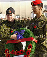 Memorial Service– On 11 November 2004 at Kabul, Afghanistan, a wreath in honour of Canadian Soldiers killed in Afghanistan is laid on the Camp Julien Memorial by Corporal April Pettipas (Left) and Cpl Karin Simmons during the Remembrance Day parade at Camp Julien in Kabul, Afghanistan. Cpl Pettipas is the cousin of Private Nathan L. Smith who was killed by friendly fire on 17 April 2002 in 