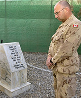 Memorial– Chief Warrant Officer Steve Bartlett, Task Force Afghanistan's Regimental  Sergeant Major takes time to reflect on the fallen. A consecration ceremony was held of the Memorial dedicated to those Canadians who gave their lives in the service of peace while serving in Afghanistan. This Memorial was  originally consecrated in November 2003 at Camp Julien, Kabul. The closure of Camp Julien in November 2005 necessitated the move of the Memorial to its present location at Kandahar Airfield, Afghanistan.  Photo taken on February 21, 2006 by: Master Corporal Ken Fenner, Task Force Afghanistan Photographer