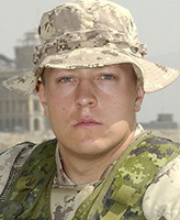 Photo of Braun Scott Woodfield– Private Braun Scott Woodfield of Victoria, B.C was killed and four other Canadian soldiers were injured when their Light Armoured Vehicle (LAV III) rolled over approximately 45 km northeast of Kandahar.  Photo credit: National Defence (photo taken on August 26, 2005, in Kabul, Afghanistan)