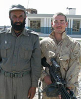 Group Photo– Pte. Joel Vincent Wiebe posing with an Afghan Police Chief in the Panjwaii District Afghanistan, Spring 2007.