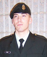 Photo of Joel Vincent Wiebe– Pte. - graduating from Basic Training at St. Jean Quebec December 2004.