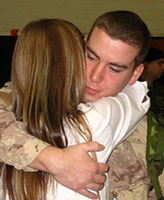 Photo of Joel Vincent Wiebe– Pte. Joel Vincent Wiebe and his Mom hugging good-bye during the very early morning hours of February 20, 2007 as he began his deployment to Afghanistan from Edmonton Garrison.