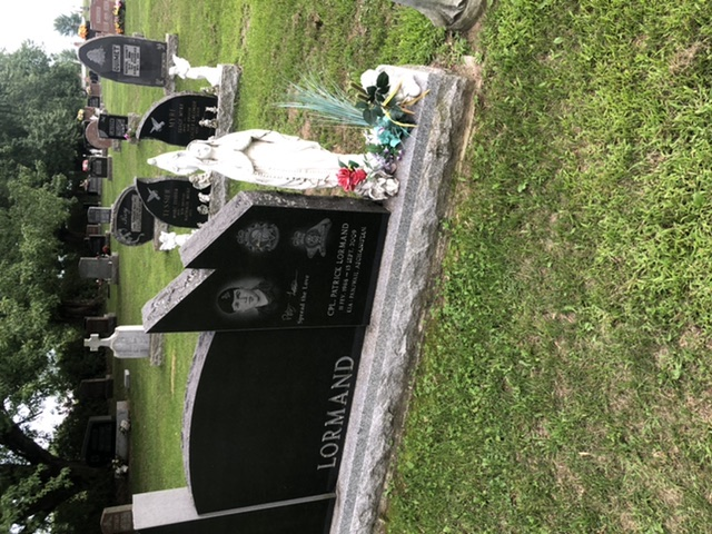 Cimetière – Ceci est une photo de la tombe de Patrick Lormand qui est située à Chute A Blondeau, Ontario. Sur sa tombe, il y a des fleurs, ainsi que 2 pièces de 25 cents et une pièce de 10 cents pour montrer qu'elle a été visitée par des ex militaires. Le site de la tombe est situé près du devant d'un petit cimetière  à côté de champs paisibles. Patrick manque à ces proches et il sera commémoré dans sa communauté, même 11 ans après son décès. Nous n'oublierons jamais ce jeune homme et comment il mit tout de côté pour sa ville, sa province et bien sûr son pays. Merci de ton service Patrick, nous nous souviendrons.