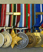 Medals– These are Sgt. John Wayne Faught's service medals. Photo provided by Phil Miller who court mounted them.