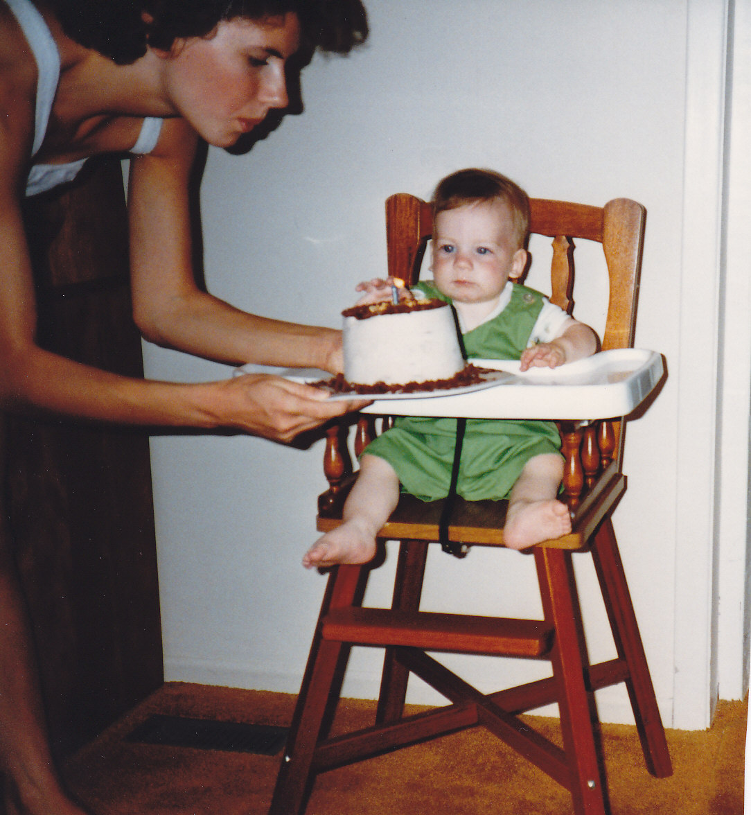 """Photo of JOSHUA CALEB BAKER– This Picture Is Of Me """"His Mother"""" And Joshua On His First Birthday. This Picture Has Shown Up Multiple Times On The Internet With Me Cropped Out Of It. I Feel It Is Only Honouring To Joshua To Set The Record Straight. I Will Not Go Into Why I Have Been Removed From The Photo But Will Say That Joshua Was My Only Child And Had No Other Siblings. There Have Been Many Twisted Stories On The Internet And In Paperwork Regarding Nonexistent Relatives. Joshua Lost All His Aunts, Uncles And Grandfather Previous To His Death Leaving Only Myself """"His Mother"""" And His Grandmother. I Feel It Is Only Right That This Photo Is Put Up In It's Original Form. The Person Or People Who Doctored This Photo Completely Disrespected Joshua And Myself His Mother. I Am Very Proud Of This Precious Photo Of My Son And I. Love, Mom"""