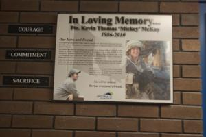 Memorial Plaque– Memorial plaque in Eastview Secondary School, Barrie, Ontario, where Private McKay formerly attended high school.  (Image taken by Gregory J. Barker of Barrie, Ontario, in 2018.)