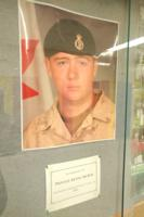 Memorial– Picture displayed in a hallway of Eastview Secondary School, Barrie, Ontario, in memory of Private Kevin McKay, Eastview graduating class of 2004.  (Image taken by Gregory J. Barker of Barrie, Ontario, in 2018.)