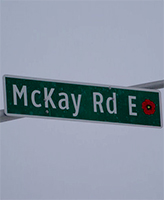 McKay Road– Street sign on McKay Road (formerly the 10th Line), Barrie, Ontario.  This road was named in memory of Private K. T. McKay.  A remembrance poppy is depicted on the right side of the sign.  (Image taken by Gregory J. Barker of Barrie, Ontario, in 2014.)