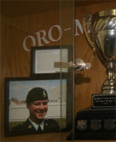 "Kevin McKay Cup– The Kevin McKay Cup, on display in the Oro-Medonte Community Arena, Guthrie, near Barrie, Ontario.  It is awarded annually to the winning team in the Kevin McKay Memorial Tyke Tournament.  This trophy was named in memory of Private Kevin T. (""Mickey"") McKay, who as a youngster played hockey in the Oro Minor Hockey Association.  (Image taken by Gregory J. Barker of Barrie, Ontario, in 2013.)"