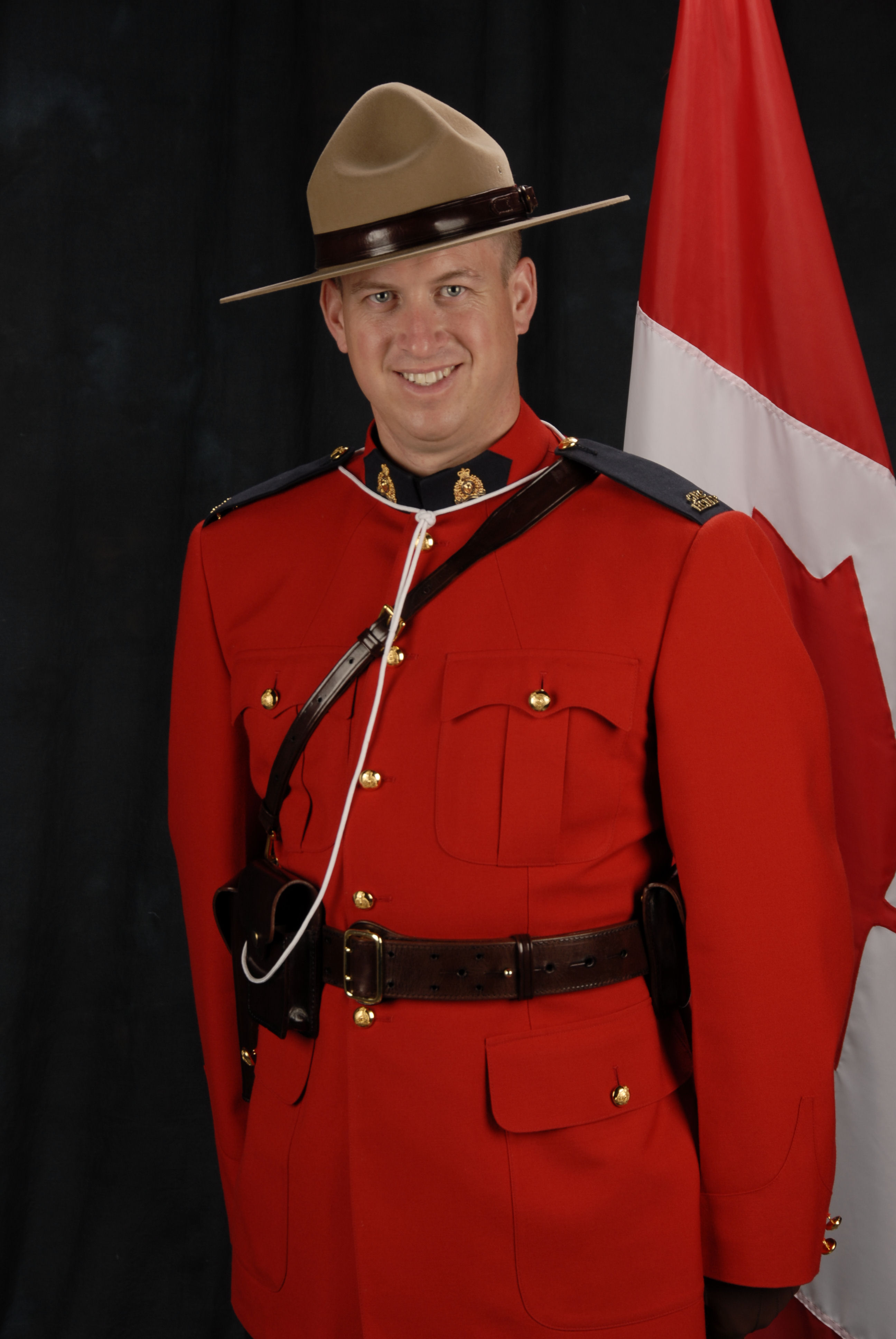Photo of DEREK WILLIAM HENRY PINEO– Cst. PINEO's happier official RCMP photograph. This is how we, his friends and troop mates, remember him. He always had a way to make everyone around him smile and laugh.