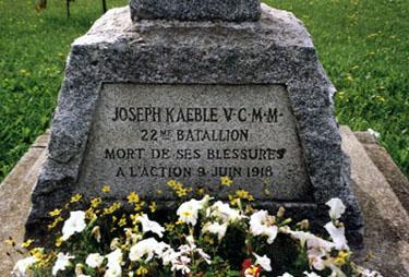 Memorial– Ce mémorial croix de granit au devant l'église Saint-Nom-de-Marie au Sayabec, QC est dédié à Joseph Kaeble, VC, MM, John C. Johnson, Louis Piché et Ludger Belliveau. Monuments commémoratifs militaires (INMCMC) 24043-007  JOSEPH KAEBLE V.C.M.M. 22ME BATALLION MORT DE SES BLESSURES A L'ACTION 9 JUIN 1918