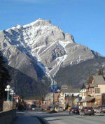 Memorial– View of Banff avenue showing the location of the Royal Canadian Legion building - near the Canadian flag.  The Banff (Alberta) War Memorial is located outdoors on the front wall of this building.