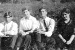 Group photo– Henry Woodroffe and Josephine Thorne, Ira Young, and Letty Woodroffe taken in Barnesdale, Ontario (Foote's Bay) about the summer of 1915.  the inscription identifying Ira is on the back of the photo.