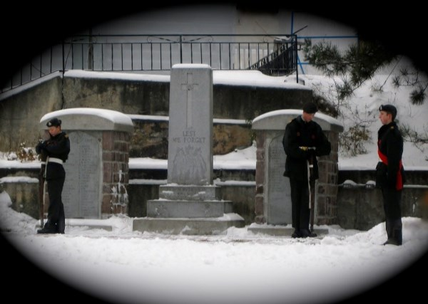 "War Memorial– ""Algonquin Regiment"" Army Cadets Standing Guard, Cenotaph, Major Edward J Holland VC Memorial Park, Cobalt Ontario, Nov 11, 2014.  Photo by Laura Landers"