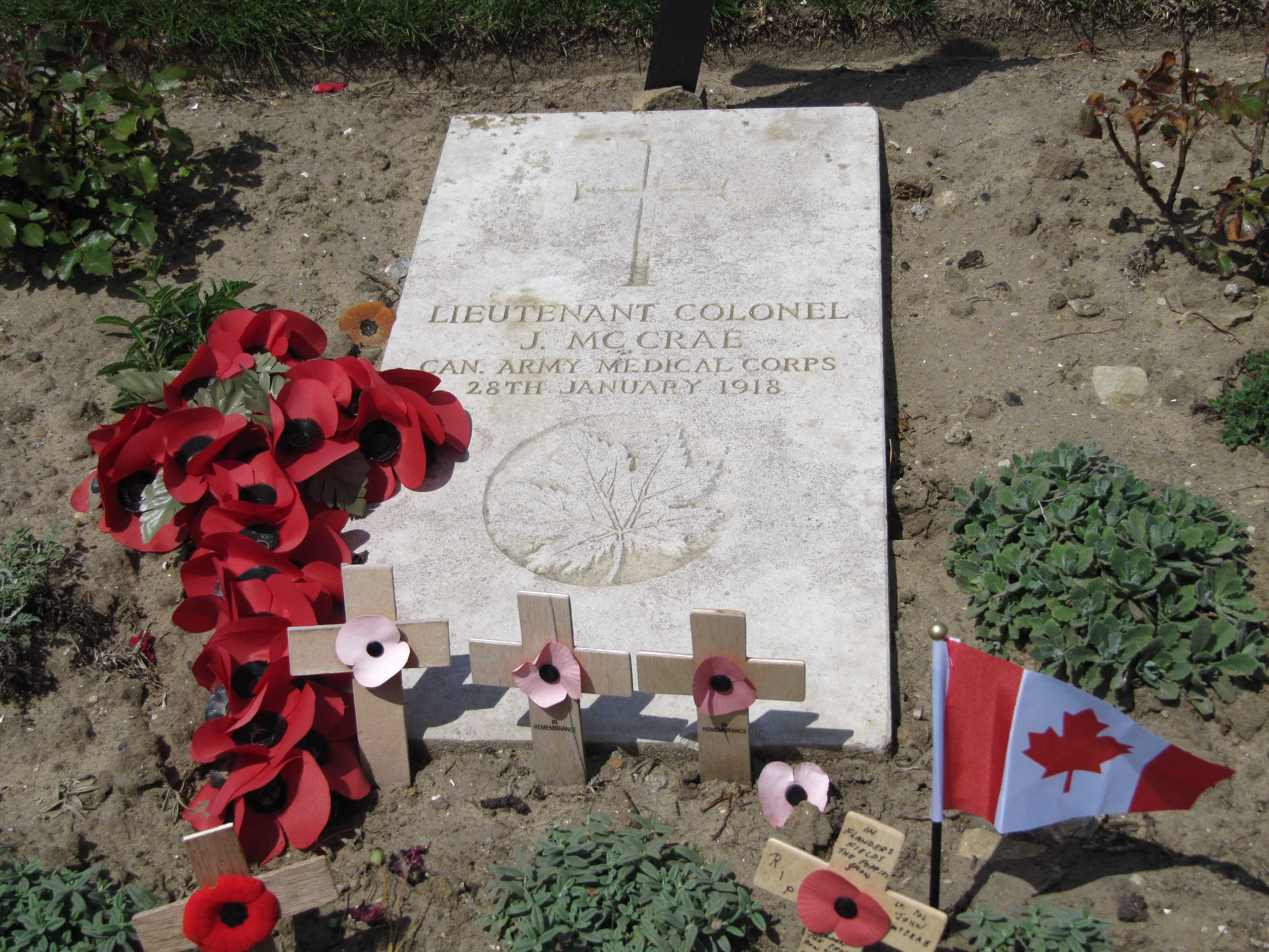 Grave marker– John McCrae's as I found it in June 2011, surrounded by tributes, as it usually is at any time of the year.