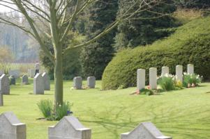 Cemetery– George Price's grave is on the right of the photo, with two Canadian flags planted in front.   On the left, the young man in the photo is standing in front of the grave of John Parr, the first British soldier killed in the Great War, on the 21st of August, 1914. Hence, the first British soldier killed in action (Parr) and the last (Price) are buried just metres apart from one another.