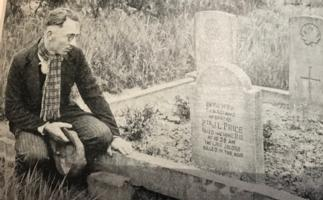 Paying respects– George Price's original grave at Havre Old Communal Cemetery, which was later moved to St Symphorien in 1948.  Photo appeared in the 1938 publication 'The Great War - I Was There' showing the grave of Pte G.L. Price, 28th Canadians, killed at 10:58 am on 11/11/18, Armistice Day. Price was the last Canadian and Commonwealth soldier to die in WW1. The man with hat in hand paying his respects is unknown, but may have been a fellow soldier or a family member.