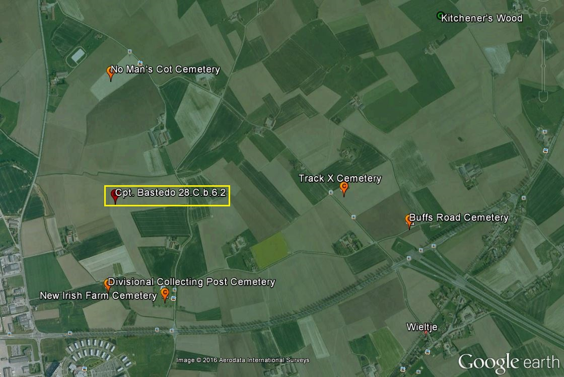 "Map– The location of the battlefield burial site of Captain Bastedo as recorded on modern day Google Earth. The red pin ""b"" in the yellow box marks the location at 28.C.b.6.2 where he was reported to have been buried on 23 April 1915. CWGC cemeteries in the immediate area of Ypres, where his remains may lie, are marked with orange ""c"" pointers. For reference to area maps, Kitchener's Wood is marked in the upper right corner of the image."