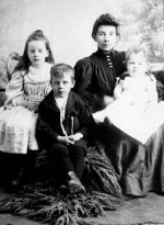 Family Photo– Left to right:  Frances, Charles and Edith Collyerwith mother Jessie (Pearson) Collyer,taken Moosomin, NWT, probably 1895Source: N. Hockin
