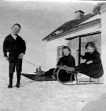 Charles with sisters– Charles toboganning with sisters Frances and Edithat home near Welwyn, NWT (Saskatchewan), winter 1896-97 Source: N. Hockin