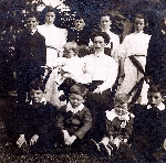 Charles Collyer with his siblings and step-mother– Charles Collyer with his siblings and step-mother at home, London Ontario, 1908.  Left to right. Back row:  Cyril, Edith, Charles, Frances, Ethel and Ralph.  Middle row:  Olive with mother Emily (Lewarton) Collyer.  Front row:  Eric, Percy, Gerald and Ernie Collyer.